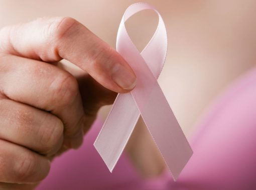 landscape-1508233954-woman-with-breast-cancer-ribbon
